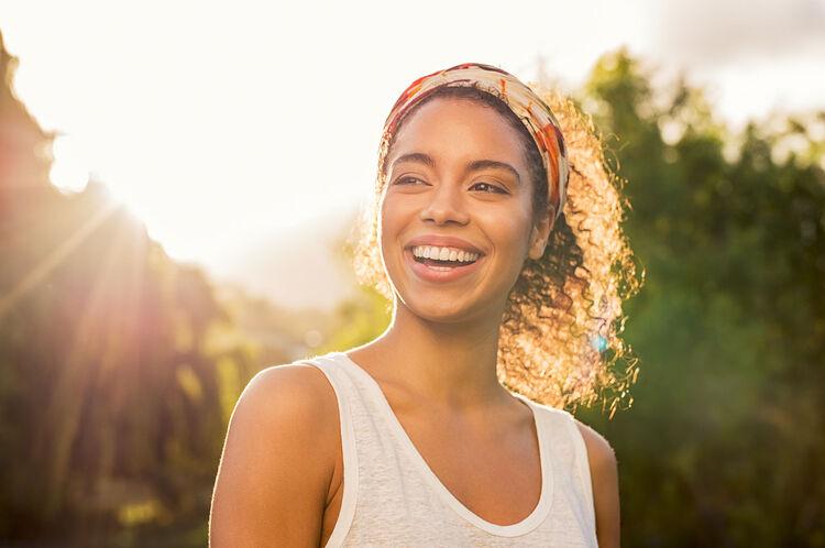 Smiling woman, wearing headband